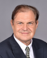 Dr. Claude Béglé
